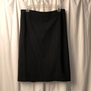 Dresses & Skirts - Black skirt with ruffle in back